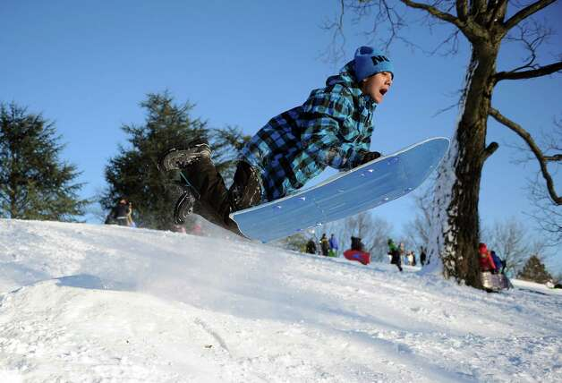 Zai Nishimura catches air on a hill in Cummings Park in Stamford, Conn., on Saturday, February 9, 2013. Photo: Lindsay Perry / Stamford Advocate