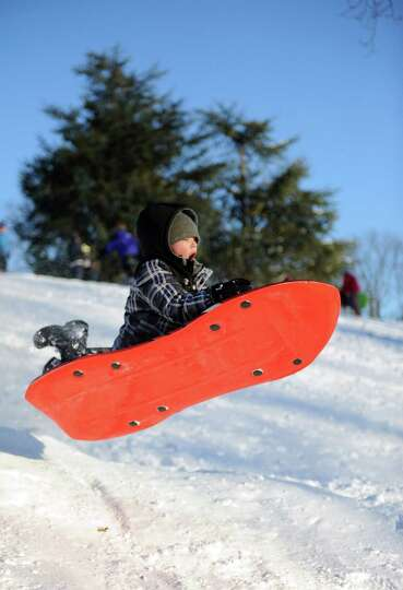 Liam Baird, 9, catches air on a hill in Cummings Park in Stamford, Conn., on Saturday, February 9, 2