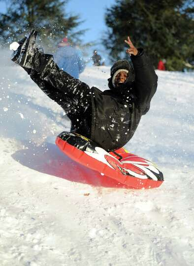 A sledder catches air on a hill in Cummings Park in Stamford, Conn., on Saturday, February 9, 2013.