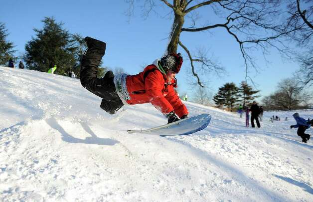 Baylor Bridges catches air on a hill in Cummings Park in Stamford, Conn., on Saturday, February 9, 2013. Photo: Lindsay Perry / Stamford Advocate