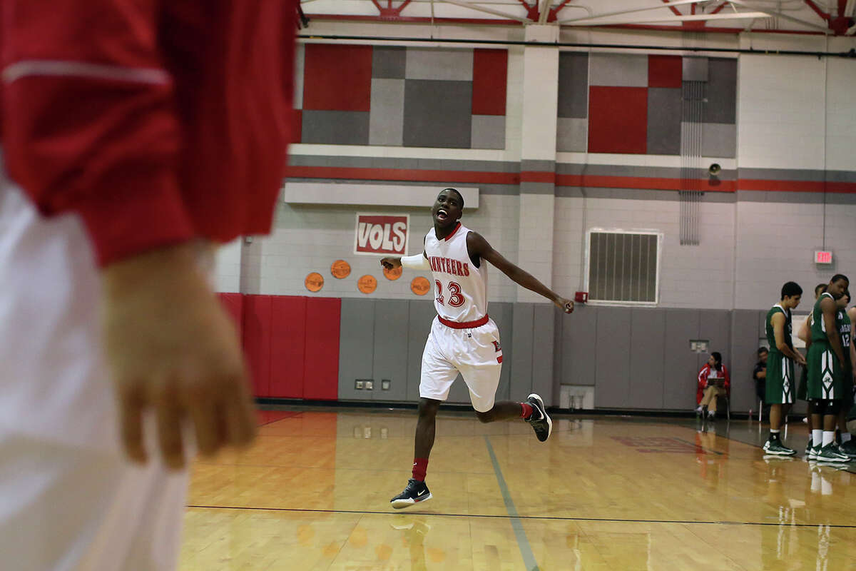 Lee High School's Farah Yussuf runs on the court as the starters are introduced for their game against Reagan in San Antonio on Friday, Jan. 25, 2013. Yussuf came to the San Antonio from a refugee camp in Kenya with his family, who were Somali Bantu refugees, in 2004.