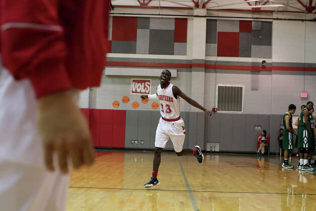 Lee High School's Farah Yussuf runs on the court as the starters are introduced for their game against Reagan in San Antonio on Friday, Jan. 25, 2013. Yussuf came to the San Antonio from a refugee camp in Kenya with his family, who were Somali Bantu refugees, in 2004. Photo: Lisa Krantz, Express-News / © 2012 San Antonio Express-News