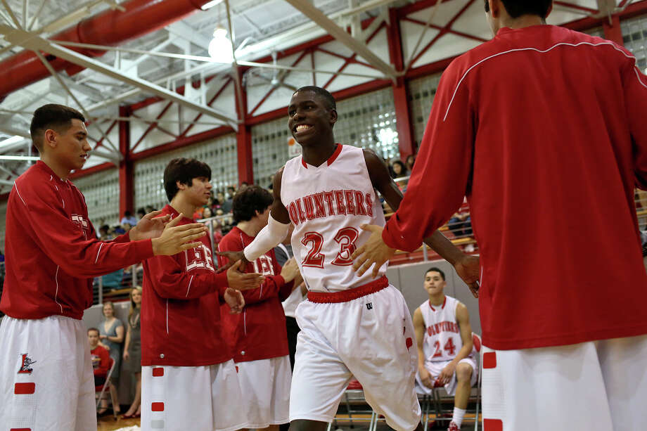Lee High School's Farah Yussuf runs onto the court as the starters are introduced for their game against Reagan in San Antonio on Friday, Jan. 25, 2013. Yussuf came to the San Antonio from a refugee camp in Kenya with his family, who were Somali Bantu refugees, in 2004. Photo: Lisa Krantz, Express-News / © 2012 San Antonio Express-News