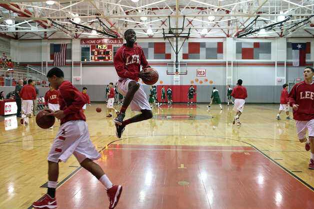 Lee High School's Farah Yussuf warms up for his team's game against Reagan in San Antonio on Friday, Jan. 25, 2013. Yussuf came to the San Antonio from a refugee camp in Kenya with his family, who were Somali Bantu refugees, in 2004. Photo: Lisa Krantz, Express-News / © 2012 San Antonio Express-News