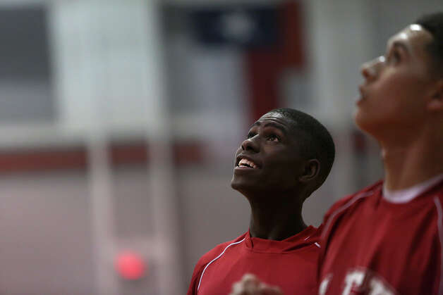 Lee High School's Farah Yussuf gets ready for his team's game against Reagan in San Antonio on Friday, Jan. 25, 2013. Yussuf came to the San Antonio from a refugee camp in Kenya with his family, who were Somali Bantu refugees, in 2004. Photo: Lisa Krantz, Express-News / © 2012 San Antonio Express-News