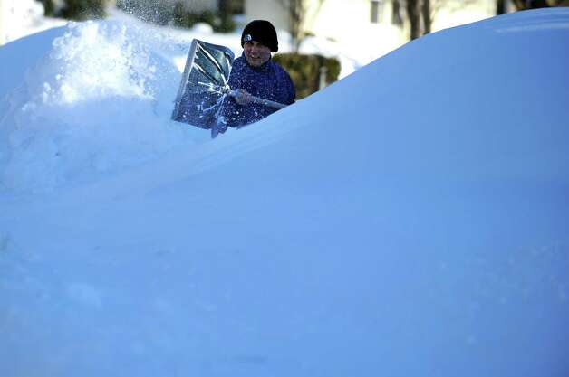 Haci Demir tries to find his car buried beneath the snow in Derby, Conn. Saturday, Feb. 9, 2013 following a severe blizzard that dumped up to three feet of snow across the state. Photo: Autumn Driscoll