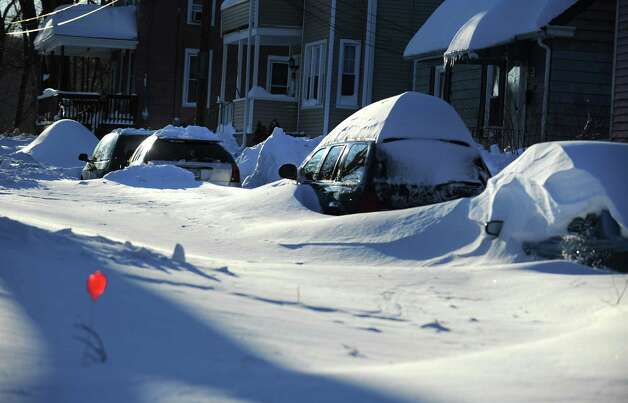 Most side roads in Derby, Conn. remain covered in snow Saturday, Feb. 9, 2013 following a blizzard that dumped up to three feet of snow across the state. Photo: Autumn Driscoll