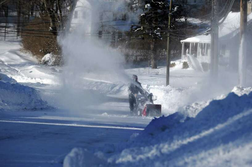 Residents in Derby, Conn. face massive snow removal Saturday, Feb. 9, 2013 following a severe blizza