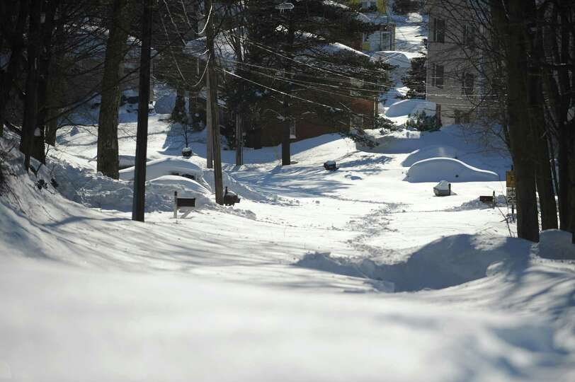 Most side roads in Derby, Conn. remain covered in snow Saturday, Feb. 9, 2013 following a blizzard t