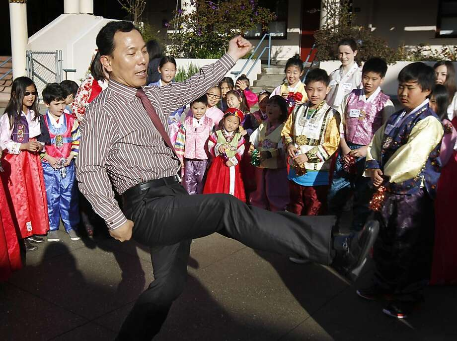 Joosik Shin, with the Korean Education Center for the Republic of Korea's consulate, demonstrates how to kick a jegichagi, which is similar to a hackysack. Students celebrateed Seol Nal, the Korean Lunar New Year, at the Claire Lilienthal School in San Francisco, Calif. on Friday, Feb. 8, 2013. Students in the Korean-immersion program wore traditional hanbok outfits and participated in a variety of activities to celebrate the lunar new year, which begins Sunday. Photo: Paul Chinn, The Chronicle