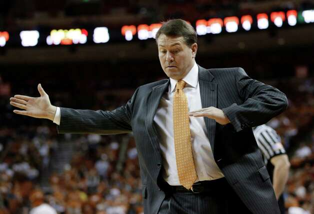 Oklahoma State coach Travis Ford signals to his players during the second half of an NCAA college basketball game against Texas, Saturday, Feb. 9, 2013, in Austin, Texas. Oklahoma State won 72-59. (AP Photo/Eric Gay) Photo: Eric Gay, Associated Press / AP