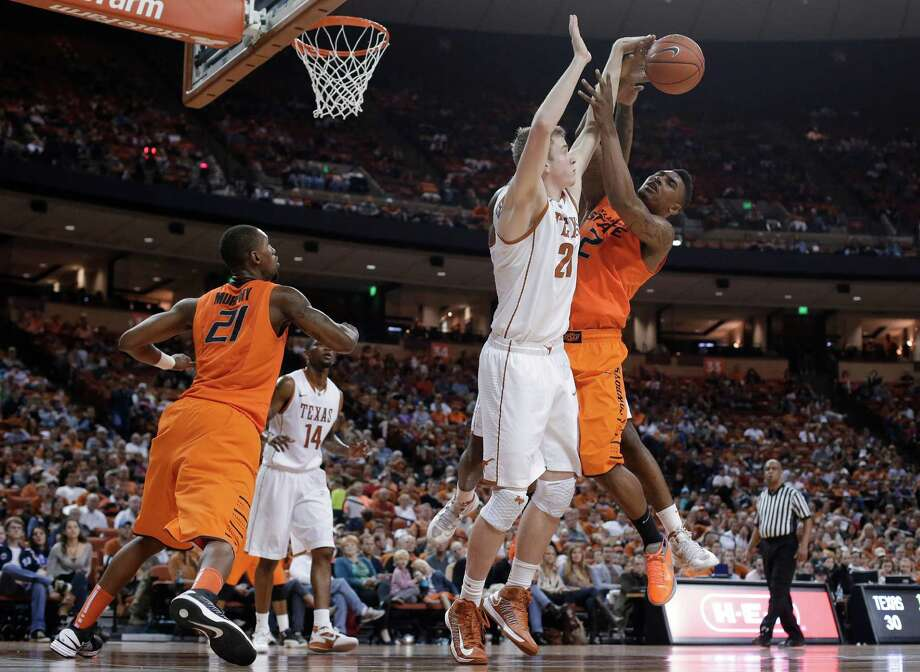 Oklahoma State's Le'Bryan Nash (2) is defended by Texas' Connor Lammert (21) as he tries to shoot during the second half of an NCAA college basketball game, Saturday, Feb. 9, 2013, in Austin, Texas. Oklahoma State won 72-59. (AP Photo/Eric Gay) Photo: Eric Gay, Associated Press / AP