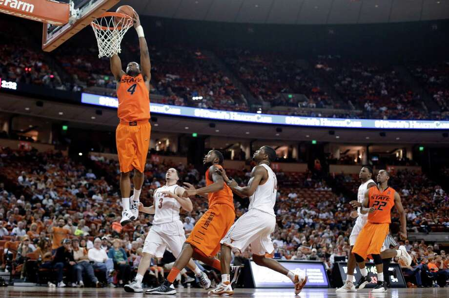 Oklahoma State's Brian Williams (4) scores against Texas during the second half of an NCAA college basketball game, Saturday, Feb. 9, 2013, in Austin, Texas. Oklahoma State won 72-59. (AP Photo/Eric Gay) Photo: Eric Gay, Associated Press / AP