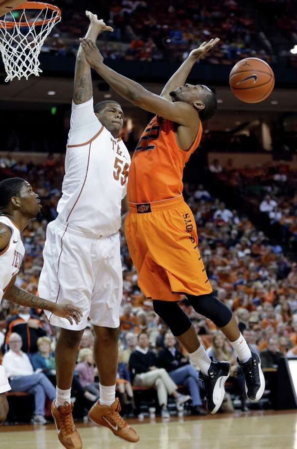Oklahoma State's Markel Brown (22) is blocked by Texas' Cameron Ridley (55) during the second half of an NCAA college basketball game, Saturday, Feb. 9, 2013, in Austin, Texas. Oklahoma State won 72-59. (AP Photo/Eric Gay) Photo: Eric Gay, Associated Press / AP