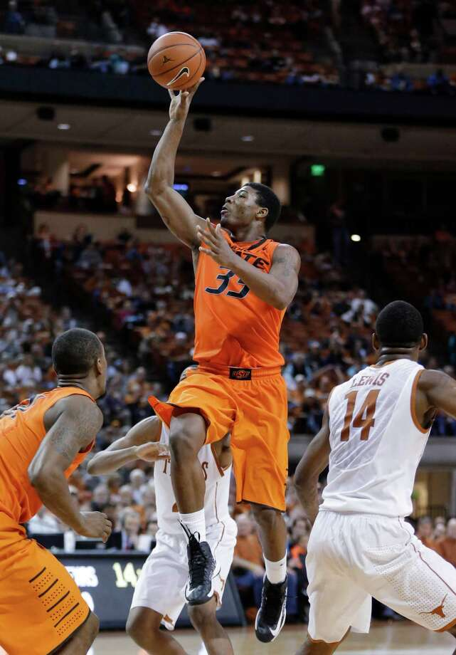 Oklahoma State's Marcus Smart (33) shoots against Texas during the second half of an NCAA college basketball game, Saturday, Feb. 9, 2013, in Austin, Texas. Oklahoma State won 72-59. (AP Photo/Eric Gay) Photo: Eric Gay, Associated Press / AP