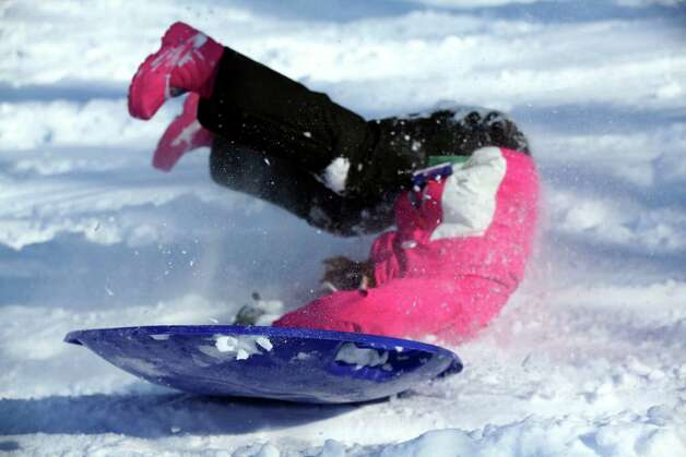 Emma Schwartz, 9, wipes out while sledding at Gedney Park in Chappaqua, N.Y., Feb. 9, 2013. A powerful storm swept across the Northeast Saturday, dumping more than three feet of snow in parts of Connecticut and more than two feet on Long Island and Massachusetts and leaving hundreds of thousands of people without power. Photo: SUZANNE DECHILLO, NYT / NYTNS