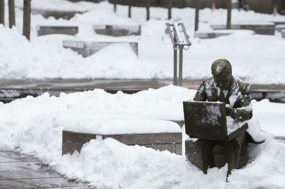 "The sculpture ""Double Check"" by John Seward Johnson II is seen in Zuccotti Park following a major winter storm on February 9, 2013 in New York City. New York City and much of the Northeast received a foot or more of snow through Saturday morning with possible record-setting blizzard conditions expected. Heavy snow warnings are in effect from New Jersey through southern Maine. Photo: Andrew Kelly, Getty Images / 2013 Getty Images"