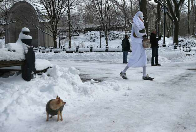 A mime walks through a snow-covered Central Park on February 9, 2013 in New York City. The park received almost a foot of snow, as New York was spared the worst of the massive snow storm that hit the U.S. Northeast. Photo: John Moore, Getty Images / 2013 Getty Images