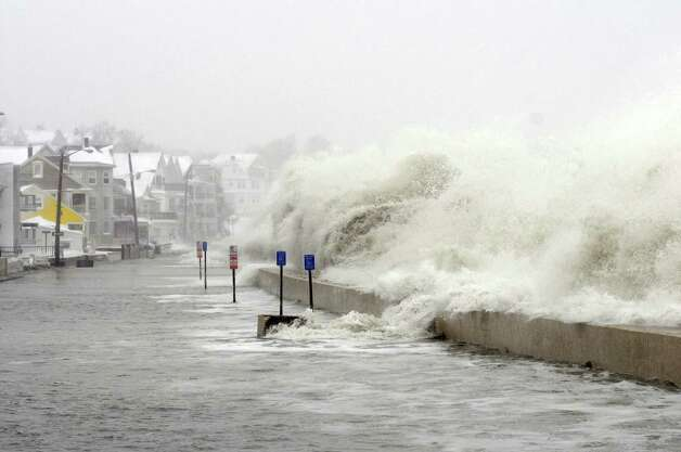 The ocean overflows the sea wall on Winthrop Shore Drive February 9, 2013 in Winthrop, Massachusetts.  An overnight blizzard left one to two feet of snow in areas, and coastal flooding is expected as the storm lingers into the day. Photo: Darren McCollester, Getty Images / 2013 Getty Images