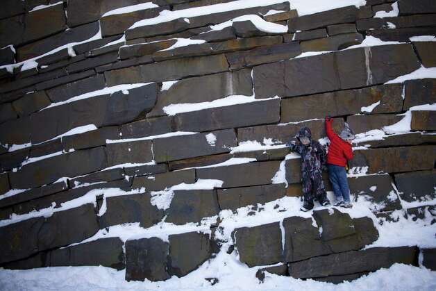Children play on a rock wall covered in snow following a major winter storm on February 9, 2013 in New York City. New York City and much of the Northeast received a foot or more of snow overnight. Heavy snow warnings are in effect from New Jersey through southern Maine. Photo: Andrew Kelly, Getty Images / 2013 Getty Images