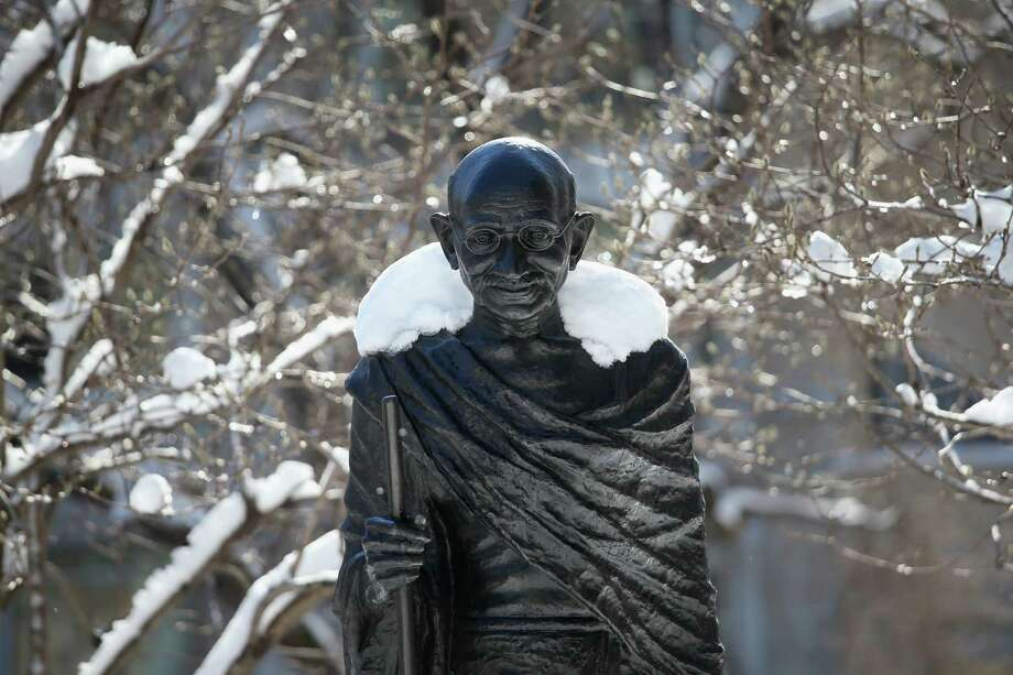 Snow blankets the shoulders of a statue of Mahatma Gandhi in Union Sqaure on February 9, 2013 in New York City. Much of the city received almost a foot of snow, as New York was spared the worst of the massive snow storm that hit the U.S. Northeast. Photo: John Moore, Getty Images / 2013 Getty Images