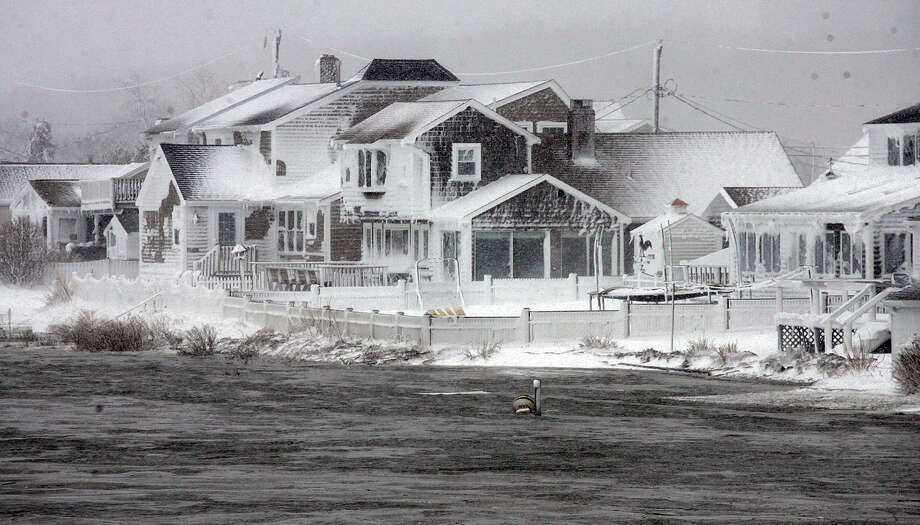 Wet snow coats houses along the South River at high tide in the Humarock coastal neighborhood of Scituate Mass. on Saturday, Feb. 9, 2013. A behemoth storm packing hurricane-force wind gusts and blizzard conditions swept through the Northeast overnight. Photo: Greg Derr, Associated Press / The Patriot Ledger