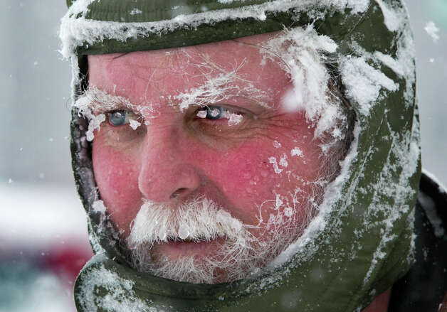 Ice clings to Ken Anderson's eyebrows and mustache as he uses a snowblower during a blizzard, Saturday, Feb. 9, 2013, in Portland, Maine. The storm dumped more than 30 inches of snow as of Saturday afternoon, breaking the record for the biggest storm on record. Photo: Robert F. Bukaty, Associated Press / AP