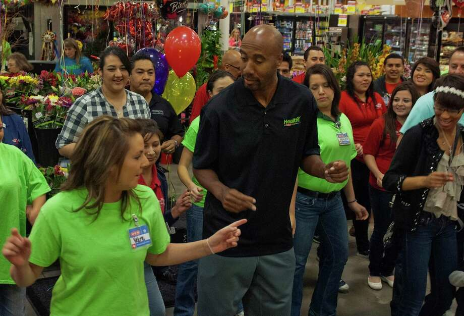 Retired San Antonio Spur Bruce Bowen (middle) joins HEB officers, employees and customers as they break out in dance to the the song Cupid Shuffle at the HEB on 5910 Babcock Rd, Feb. 9, 2013. The dance break is in support of American Heart Month. Photo: Steve Faulisi, San Antonio Express-News / ©2013 San Antonio Express-News