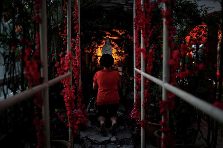 An ethnic Chinese worships ahead of Chinese New Year celebrations at the Thean Hou Temple in Kuala Lumpur on February 9, 2013. Chinese New Year which is also known as Lunar Year falls on February 10. Photo: MOHD RASFAN, AFP/Getty Images / AFP