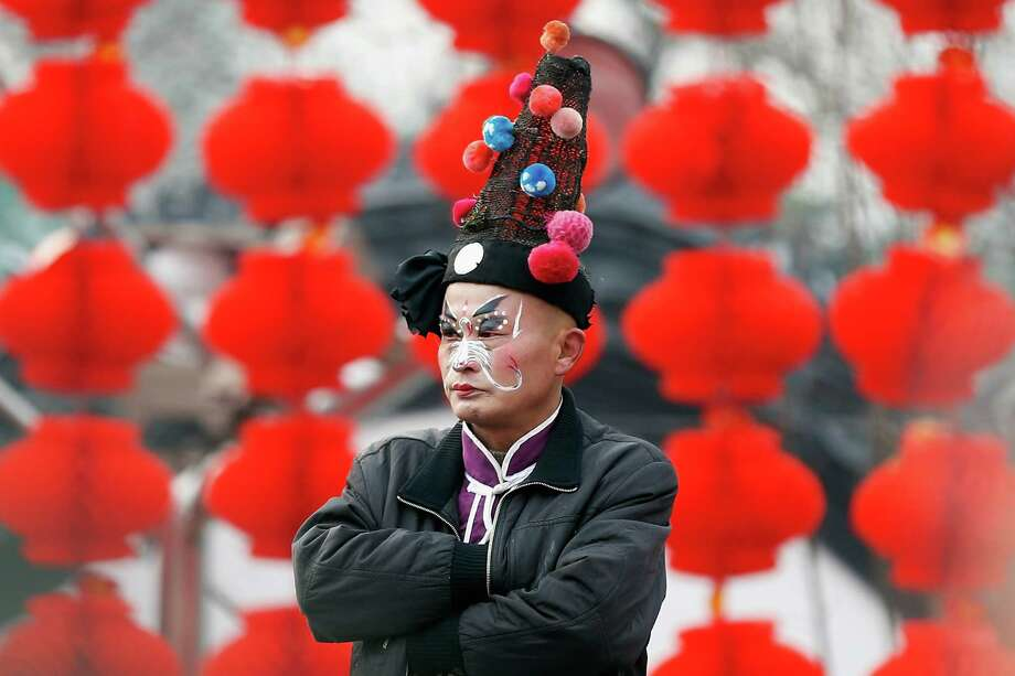 Chinese folk artists prepare to perform during the opening ceremony of the Spring Festival Temple Fair at Dragon Lake Park on February 9, 2013 in Beijing, China.The Chinese Lunar New Year of Snake also known as the Spring Festival, which is based on the Lunisolar Chinese calendar, is celebrated from the first day of the first month of the lunar year and ends with Lantern Festival on the Fifteenth day. Photo: Lintao Zhang, Getty Images / 2013 Getty Images