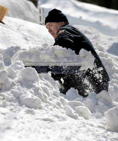 Bob Martin, of Nashville Road in Bethel, Conn. digs out after a blizzard dumps almost two feet of snow in the area Friday and early Saturday morning, Feb. 9, 2013. Photo: Carol Kaliff / The News-Times