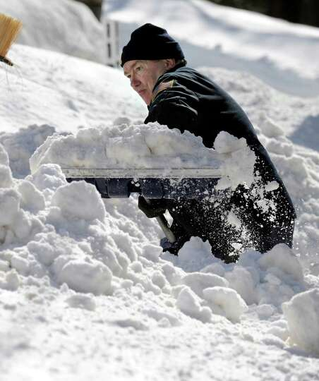 Bob Martin, of Nashville Road in Bethel, Conn. digs out after a blizzard dumps almost two feet of sn