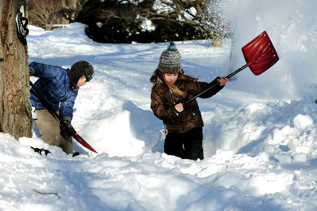 Charlie and Della Jackson work making a fort in their driveway on Stillson Rd. in Fairfield, Conn. on Friday, Feb. 9, 2013. Southwestern Connecticut was hit by one of the biggest snowstorms in history, a howling blizzard that dumped over two feet of snow across the area. Photo: Cathy Zuraw / Connecticut Post
