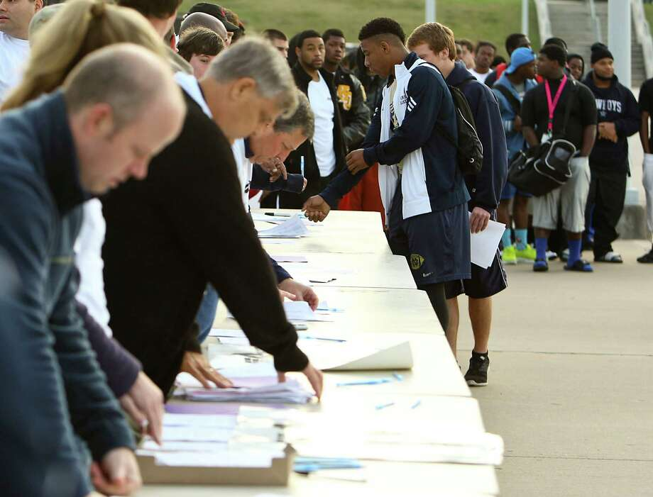 A line forms to register for the 5th Annual Greater Houston Senior Football Showcase at the Houston Texans Methodist Training Center Saturday, Feb. 9, 2013, in Houston. Photo: James Nielsen, Chronicle / © Houston Chronicle 2013