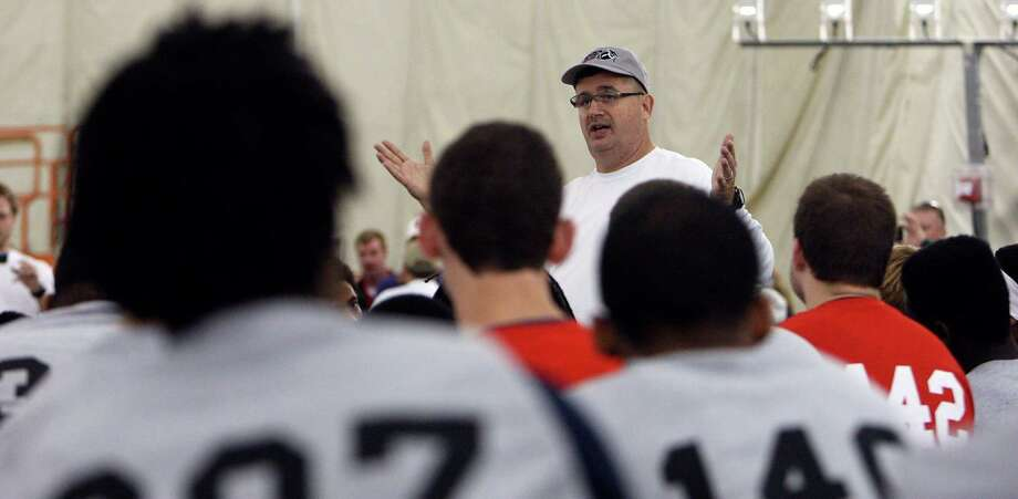 Greater Houston Football Coaches Association's Phil Camp speaks with participants of 5th Annual Greater Houston Senior Football Showcase at the Houston Texans Methodist Training Center Saturday, Feb. 9, 2013, in Houston. Photo: James Nielsen, Chronicle / © Houston Chronicle 2013