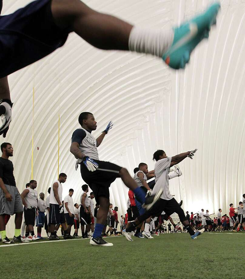Participants work on a drill during 5th Annual Greater Houston Senior Football Showcase at the Houston Texans Methodist Training Center Saturday, Feb. 9, 2013, in Houston. Photo: James Nielsen, Chronicle / © Houston Chronicle 2013