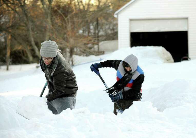 Residents continue to shovel their way out  on Judd St. in Fairfield, Conn. on Friday, Feb. 9, 2013.