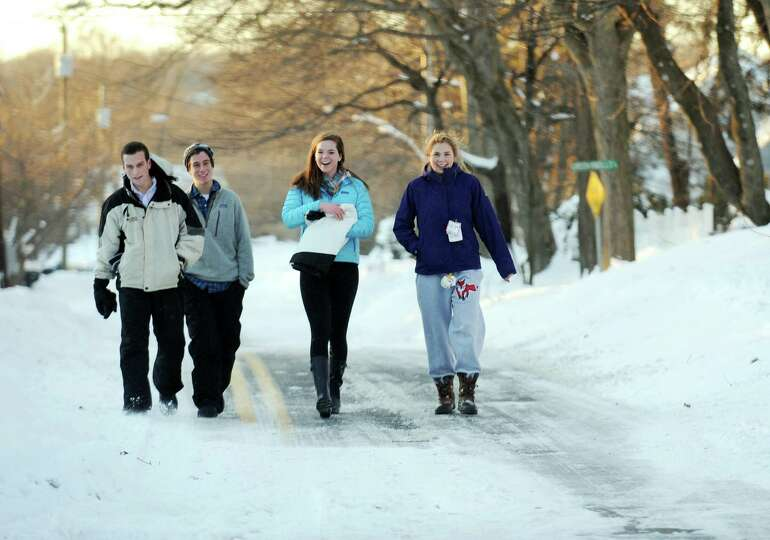 Many roads like Judd St. in Fairfield, Conn. had more pedestrians than vehicles on Friday, Feb. 9, 2