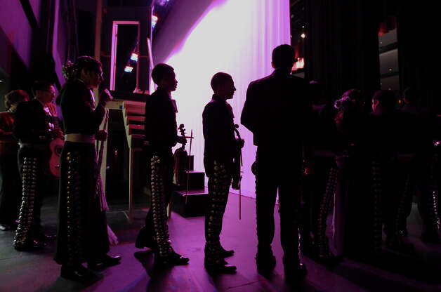 Brackenridge High School Mariachi Band members are silhouetted in stage lighting just before they perform at the Texas High School Mariachi Competition by the Mexican American School Board Association at Edgewood ISD Theater of Performing Arts on Saturday, Feb. 9, 2013. Photo: Kin Man Hui, San Antonio Express-News / © 2012 San Antonio Express-News