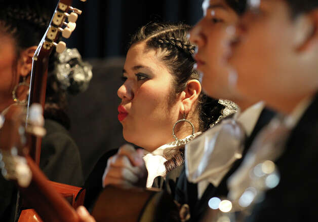 Maria Ortega warms up her vocal cords before the Brackenridge High School Mariachi Band performs in the Texas High School Mariachi Competition by the Mexican American School Board Association at Edgewood ISD Theater of Performing Arts on Saturday, Feb. 9, 2013. Photo: Kin Man Hui, San Antonio Express-News / © 2012 San Antonio Express-News