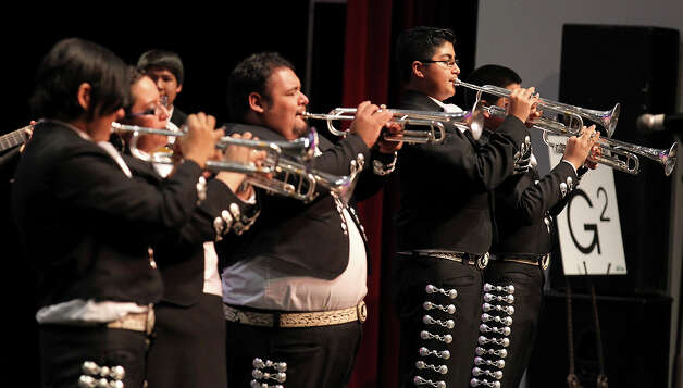 The trumpet section of the Brackenridge High School Mariachi Band takes center stage at the Texas High School Mariachi Competition by the Mexican American School Board Association at Edgewood ISD Theater of Performing Arts on Saturday, Feb. 9, 2013. Photo: Kin Man Hui, San Antonio Express-News / © 2012 San Antonio Express-News