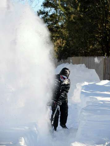 Kathleen Jackson clears her driveway on Stillson Rd. in Fairfield, Conn. on Friday, Feb. 9, 2013. Southwestern Connecticut was hit by one of the biggest snowstorms in history, a howling blizzard that dumped over two feet of snow across the area. Photo: Cathy Zuraw / Connecticut Post