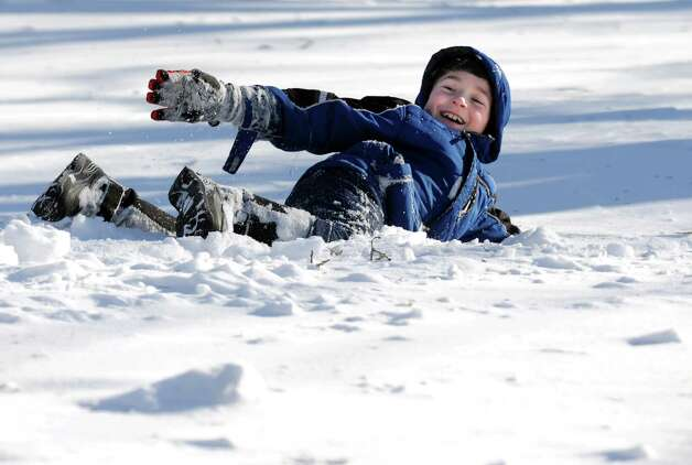 Evan Smith plays on an unshoveled Mayfair Rd. in Fairfield, Conn. on Friday, Feb. 9, 2013. Southwestern Connecticut was hit by one of the biggest snowstorms in history, a howling blizzard that dumped over two feet of snow across the area. Photo: Cathy Zuraw / Connecticut Post