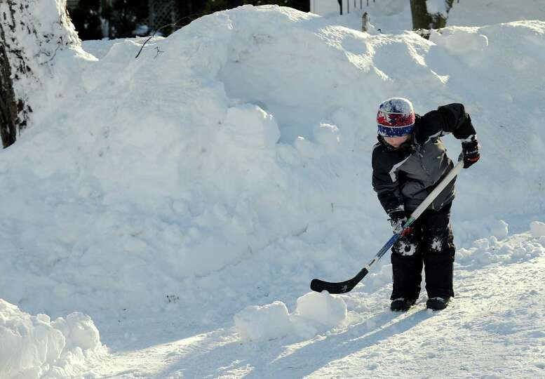 Dylan Hutzelmann makes an igloo in his driveway in Fairfield, Conn. on Friday, Feb. 9, 2013. Southwe