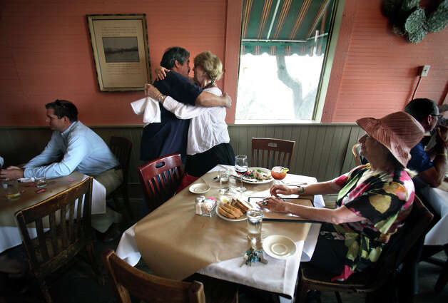 Oscar Trejo, Manager of Liberty Bar, embraces Sherry Kafka Wagner, long time patron of the historic eatery, on the last day of service before it moves to it's new location, Monday, May 17, 2010. At right is Bitsy Gorman. Photo: BOB OWEN, SAN ANTONIO EXPRESS-NEWS / SAN ANTONIO EXPRESS-NEWS