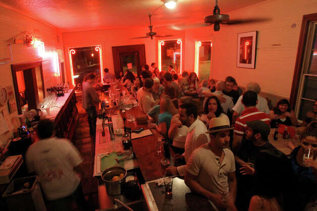 Patrons pack the bar area as they say goodbye on the last night of Liberty Bar on Monday, May 17, 2010 in San Antonio. For 25 years, the iconic San Antonio restaurant has operated on Josephine Street in a leaning house dating to the 1890s. But Dwight Hobart, the restaurant's owner, has moved the restaurant to the former St. Scholastica Convent on South Alamo Street. The restaurant is scheduled to reopen in King William with same management and menu on May 26. Photo: Jennifer Whitney, San Antonio Express-News / spoecial to the San Antonio Express-News