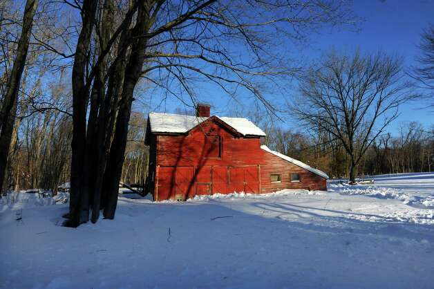 A tranquil scene of a barn on Pansy Rd. in Fairfield, Conn. on Friday, Feb. 9, 2013 gives no hint that Southwestern Connecticut was hit by one of the biggest snowstorms in history. Photo: Cathy Zuraw / Connecticut Post
