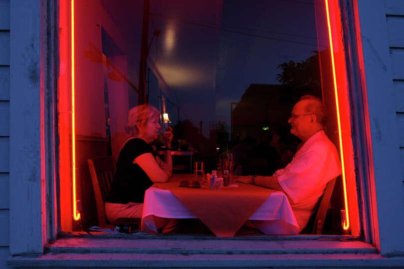 Judy (left) and George Schroeder enjoy dinner at Liberty Bar Thrusday July 9, 2009. The restauran