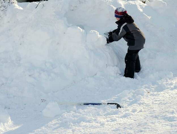 Dylan Hutzelmann makes an igloo in his driveway in Fairfield, Conn. on Friday, Feb. 9, 2013. Southwestern Connecticut was hit by one of the biggest snowstorms in history, a howling blizzard that dumped over two feet of snow across the area. Photo: Cathy Zuraw / Connecticut Post