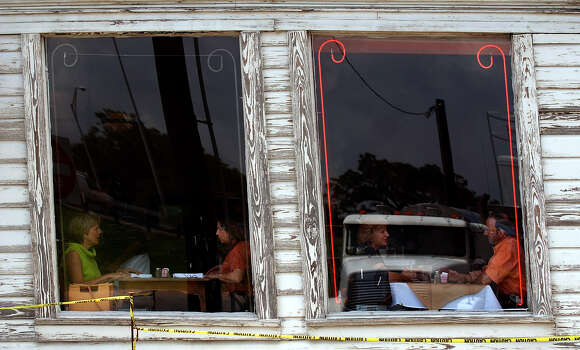"The well-known Liberty Bar undergoes maintenance to shore up its foundation. The ""tilt"" of the structure remains as its distinct feature. Patrons Sandy Wolfington (from left), Pita Pollock, Barbara Bowie and Albert Estrada take the window seats to enjoy lunch on Thursday, July 17, 2003. Photo: KIN MAN HUI, SAN ANTONIO EXPRESS-NEWS / SAN ANTONIO EXPRESS-NEWS"
